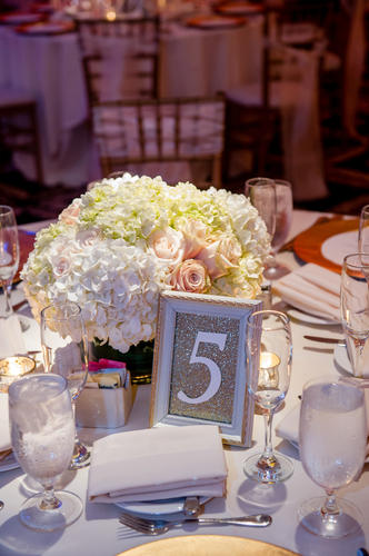 A shabby-chic-meets-gilded-gold table number created by No Worries; flowers by Flower Duet