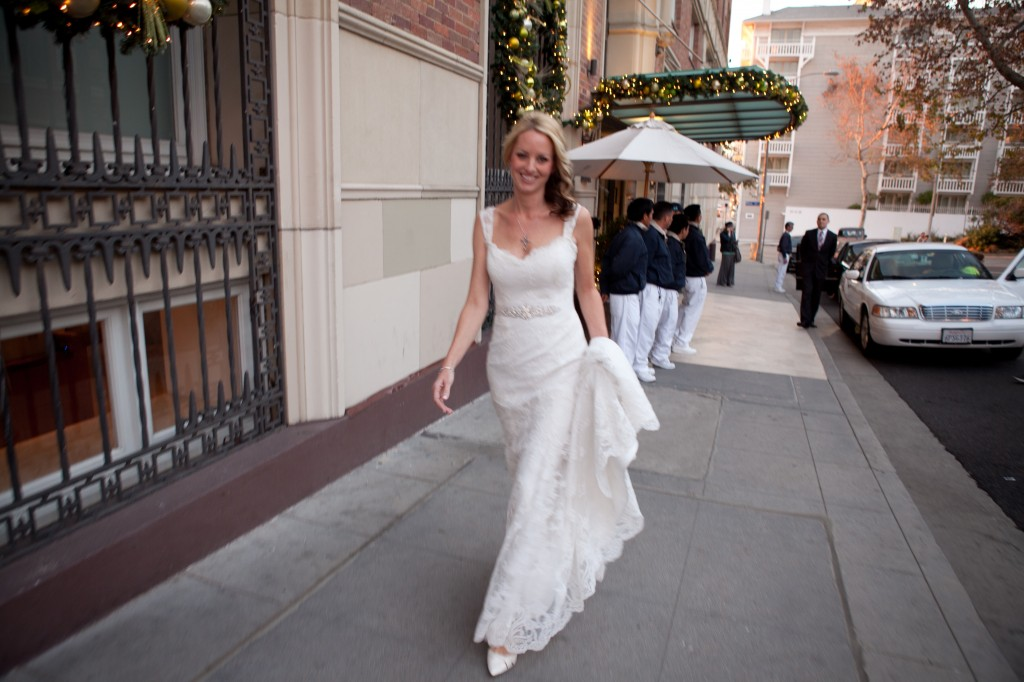 An unplanned moment - beautiful bride, city sidewalk.  Photo by Don't Smile Now/ Shani Barel.