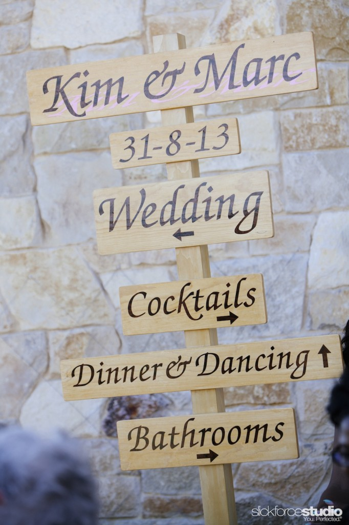 The father of the bride is a master sign maker and artist, and custom created wood signage, like this directional sign.  Photo by Slickforce/Nick Saglimbeni, florals by Lotus and Lily.