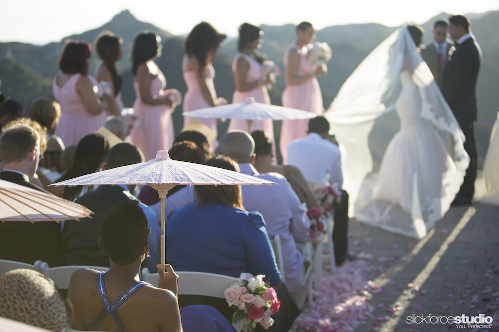 Parasols shielded guests from the sun.  Photo by Slickforce/Nick Saglimbeni
