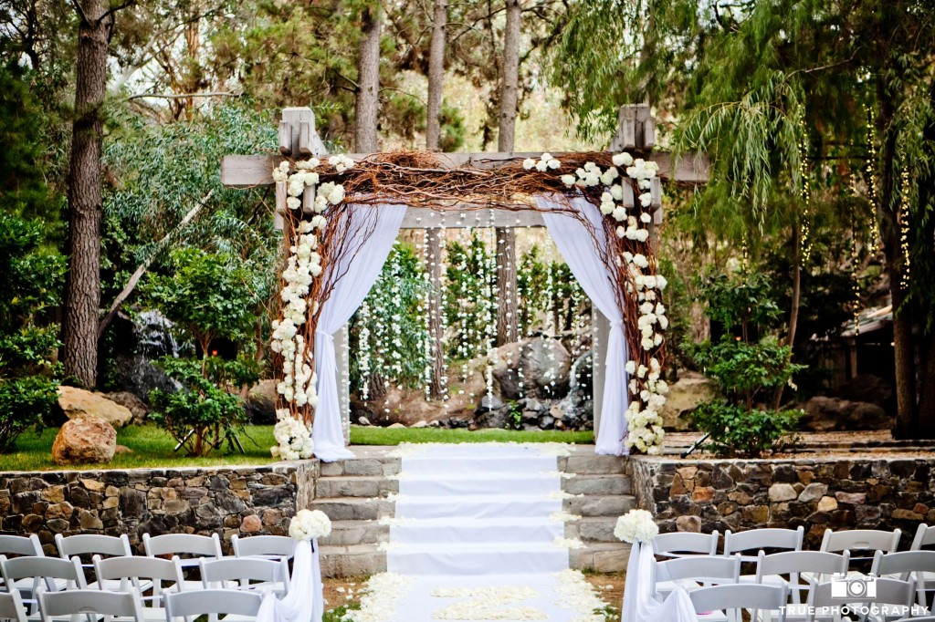 A beautifully dressed arch at Calamigos Malibu by Butterfly Floral.  Photo by True Photography Weddings.