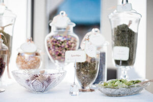 A tea bar featuring key ingredients from Pixi's skin care line.