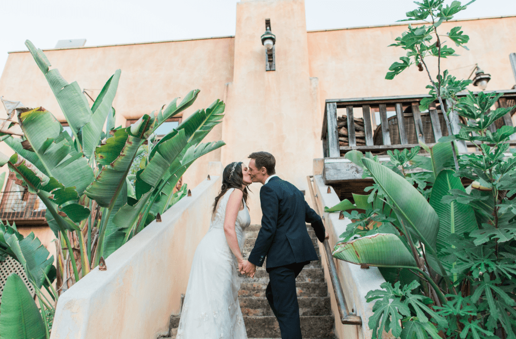 kiss on stairs mountain mermaid los angeles wedding