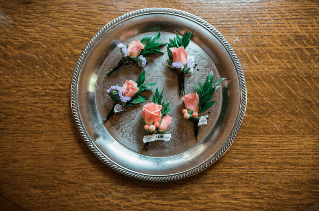 Boutonnieres peach greenery silver tray