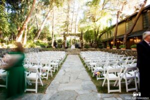Calamigos white folding chairs ceremony space