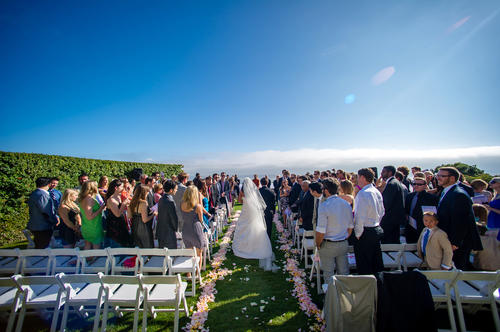 Visualizing an ocean view can also soothe your mind. Photo by Sam Lim Studios, florals by Flower Duet.