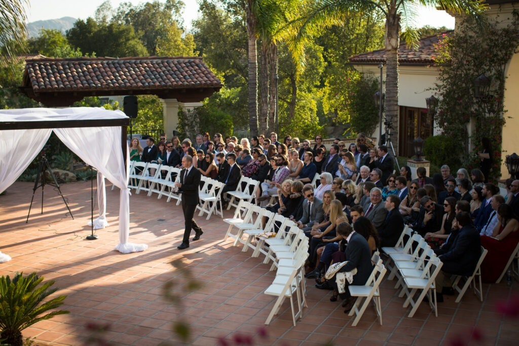 Hummingbird nest ceremony venue with white chairs