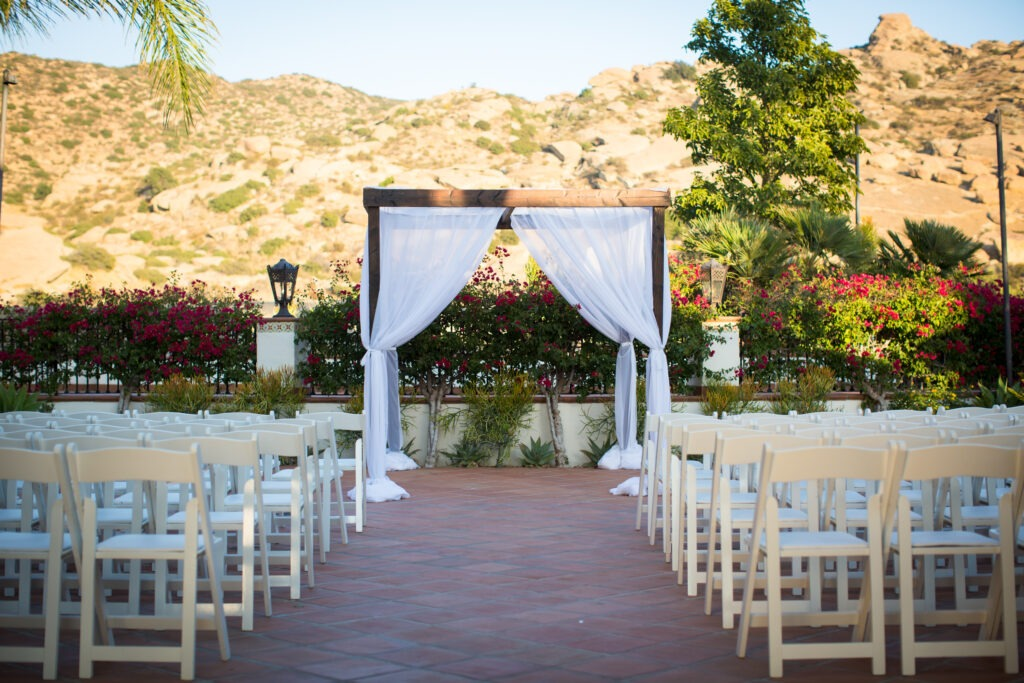 Hummingbird wedding ceremony with drapes and wood chuppah