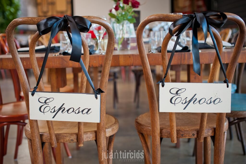 Spanish bride and groom chair signage
