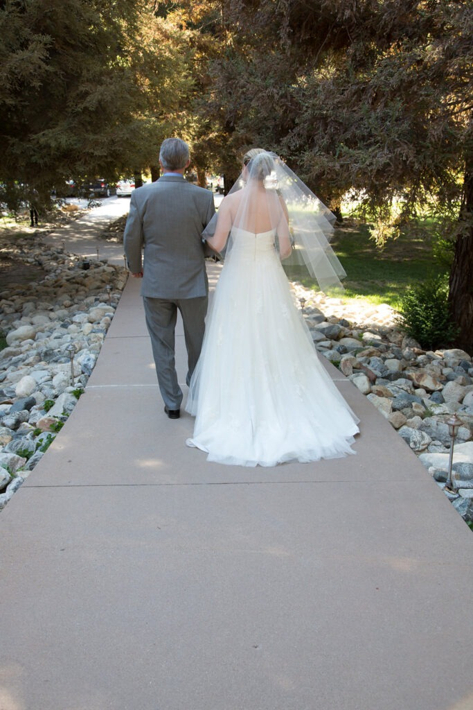 Bride and Father Walking down Aisle at Outdoor wedding