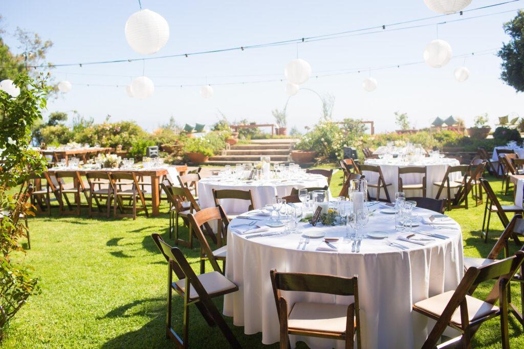 Wedding Reception at Rancho Del Cielo, Malibu, with dark wood folding chairs