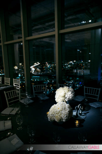 Flower Duet's modern centerpieces, pinspotted by TMMPro Lighting. Photo by Callaway Gable.