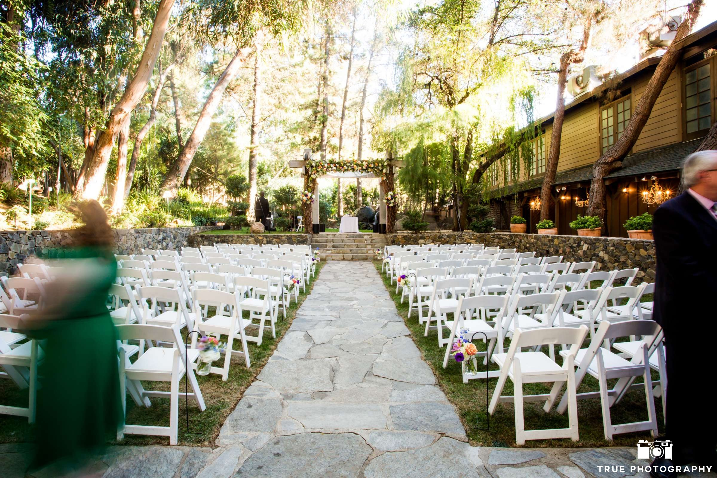 All set and ready to go...starting a ceremony on time takes careful prep in the weeks prior to the big day. Photo by True Photography. Venue: Calamigos Malibu. Florals: McCann Florist.