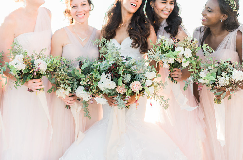 Bridesmaids Blush bridesmaid gowns greenery rustic bouquets