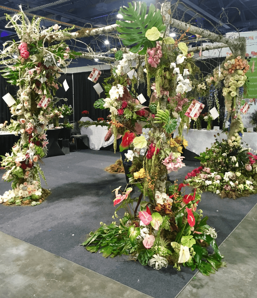 Chuppah with fruit and orchids from fifty flowers